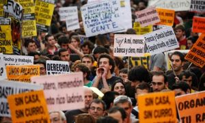 A protester shouts slogans during a demonstration in Madrid